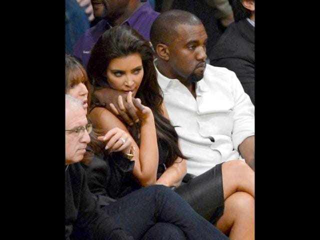 Kanye-West-puts-his-arm-around-Kim-Kardashian-from-their-courtside-seats-as-the-Los-Angeles-Lakers-take-on-the-Denver-Nuggets-in-Game-Seven-of-the-Western-Conference-Quarterfinals-in-the-2012-NBA-Playoffs-at-Staples-Center-in-Los-Angeles-California-AFP-Kevork-Djansezian