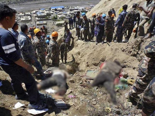 Bodies-of-victims-lie-on-the-ground-as-Nepalese-rescue-workers-inspect-the-site-of-the-crash-near-Jomsom-airport-200-kilometers-northwest-of-the-capital-Katmandu-Nepal-AP-Photo