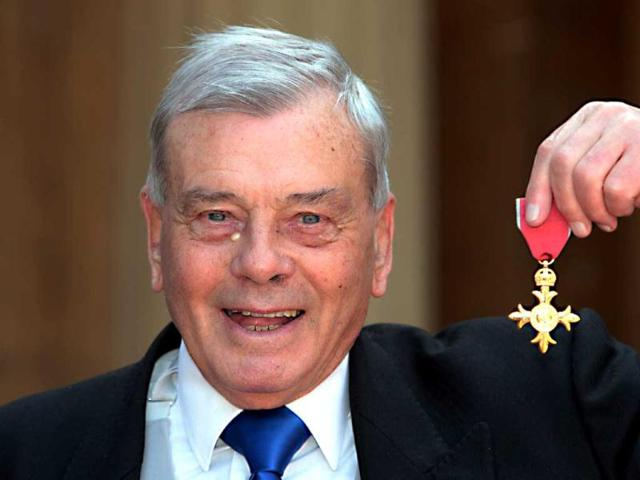 Former-British-cricket-umpire-Harold-Dickie-Bird-poses-for-pictures-after-receiving-the-Officer-of-the-British-Empire-OBE-which-was-presented-to-him-by-Prince-Charles-at-Buckingham-Palace-in-London-AFP-Photo-Sean-Dempsey-POOL