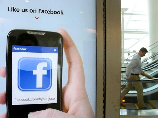 An-advertisement-at-San-Jose-International-Airport-suggests-users-to-like-the-airport-s-Facebook-page-Studies-have-found-that-users-spend-far-more-time-with-the-mobile-version-of-Facebook-s-network-than-they-do-on-the-browser-version-but-raising-advertising-revenues-from-the-mobile-platform-has-proven-more-difficult-than-for-the-desktop-version-AFP-Robyn-Beck