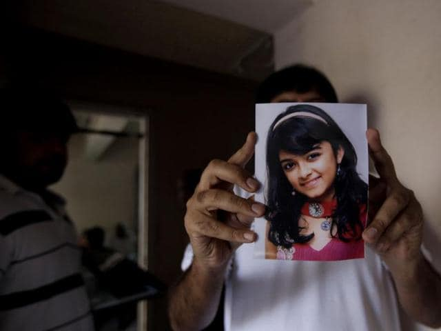 A-relative-holds-the-picture-of-child-star-Taruni-Sachdev-who-died-in-a-recent-aircrash-in-Nepal-HT-Photo-Vijayanand-Gupta