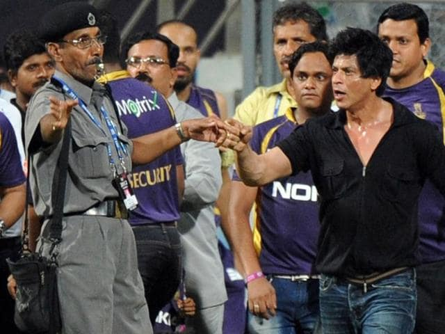 Bollywood actor and Indian Premier League franchise Kolkata Knight Riders co-owner Shah Rukh Khan gestures towards a security guard blowing a whistle to direct children accompanying him off the playing field after the IPL Twenty20 cricket match between Mumbai Indians and Kolkata Knight Riders at The Wankhede Stadium in Mumbai. AFP/Indranil MUKHERJEE