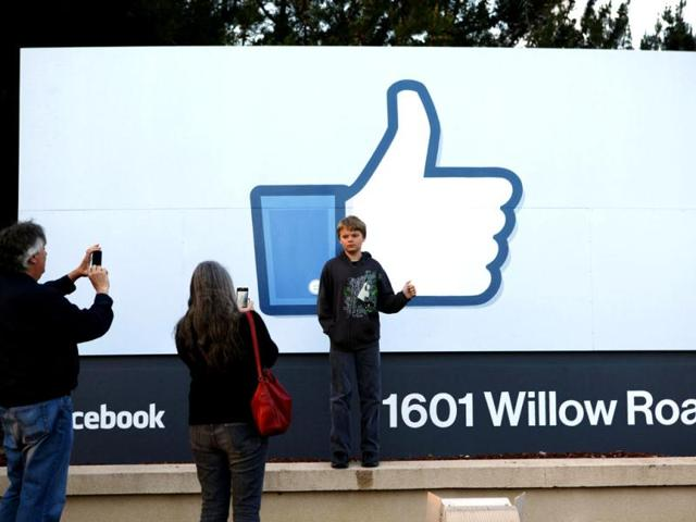 Xavier-Schmidt-of-Menlo-Park-has-his-picture-taken-by-his-parents-outside-Facebook-s-headquarters-in-Menlo-Park-California-the-night-before-the-company-s-IPO-launch-Reuters-Beck-Diefenbach