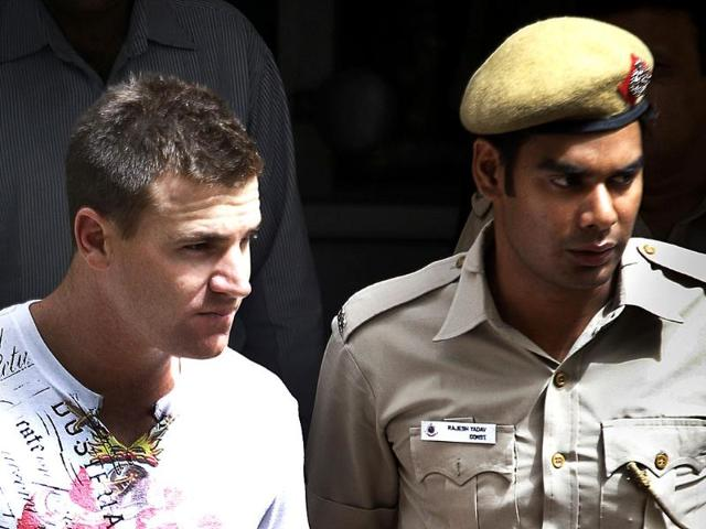 Australian-batsman-Luke-Pomersbach-left-is-escorted-by-a-policeman-to-be-produced-at-a-court-in-New-Delhi-Pomersbach-who-plays-for-Royal-Challengers-Bangalore-in-the-Indian-Premier-League-cricket-match-has-been-detained-by-Delhi-Police-for-allegedly-molesting-a-woman-and-assaulting-her-fiance-AP-Manish-Swarup