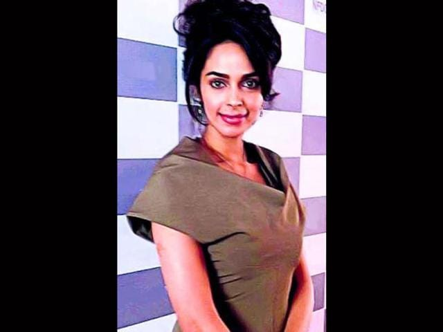 Mallika-Sherawat-in-Victoria-Beckham-outfit-at-Cannes