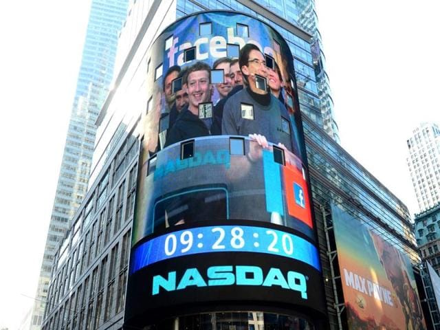 Facebook-co-founder-Mark-Zukerberg-is-seen-on-a-screen-getting-ready-to-ring-the-Nasdaq-stock-exchange-opening-bell-in-Times-Square-in-New-York-AFP-Emmanuel-Dunand