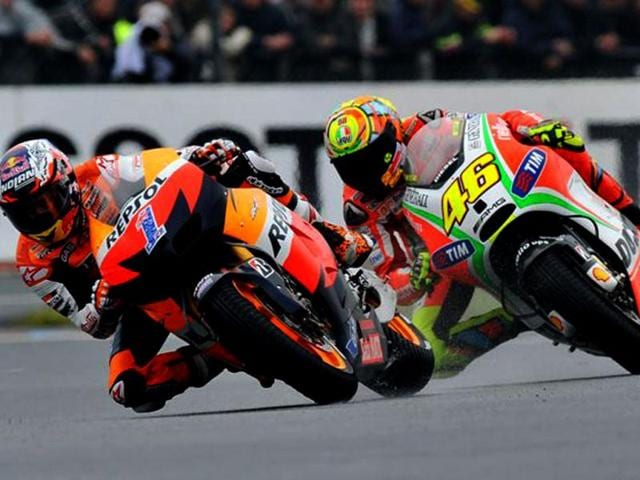 Valentino-Rossi-number-46-overtook-defending-champion-Casey-Stoner-number-1-en-route-to-second-place-his-best-finish-for-Ducati-since-joining-them-last-year-AFP-Photo