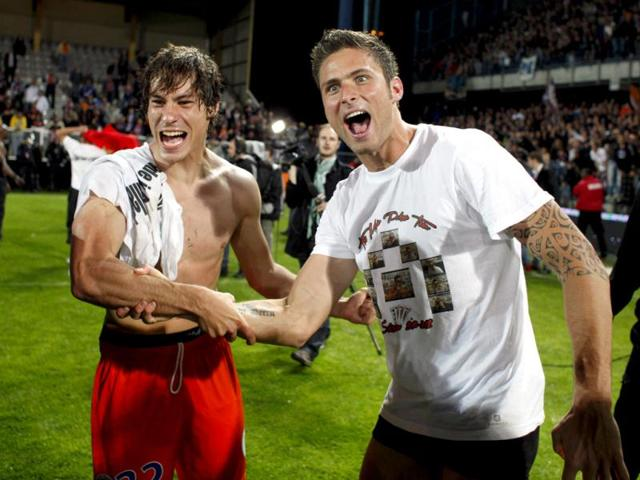Montpellier-s-Benjamin-Stambouli-left-and-Olivier-Giroud-right-celebrate-after-their-French-League-one-soccer-match-against-Auxerre-at-the-Abbe-Deschamps-stadium-in-Auxerre-central-France-Montpellier-defeated-Auxerre-2-1-and-celebrated-its-first-title-AP-Photo-Thibault-Camus