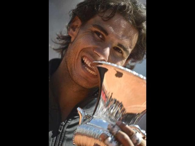 Spanish-Rafael-Nadal-celebrates-with-the-trophy-after-winning-the-AFP-Rome-Tennis-masters-Nadal-defeated-Serbian-Novak-Djokovic-7-5-6-3-AFP-Filippo-Monteforte