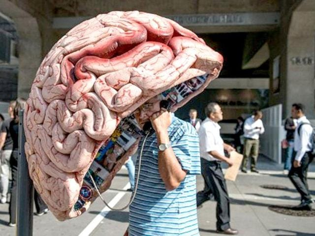 A-man-uses-a-public-phone-booth-decorated-as-a-brain-in-Sao-Paulo-Brazil-AFP-Yasuyoshi-Chiba