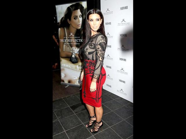 Kim-Kardashian-launches-her-perfume-True-Reflection-at-Debenhams-department-store-on-Oxford-Street-London-The-hottie-is-wearing-an-Emilio-Pucci-red-skirt-with-Emilio-Pucci-black-lace-top-and-Tom-Ford-shoes