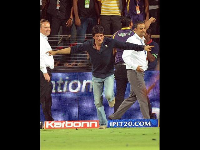 SRK runs towards the ground after the win.