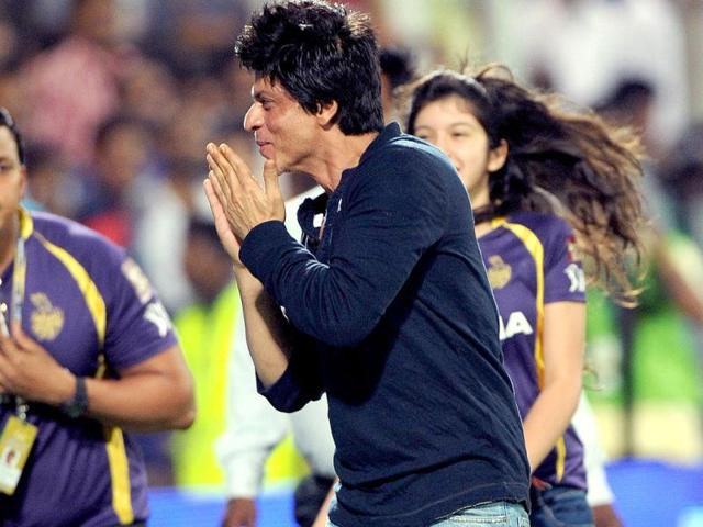 Shah Rukh Khan greets the crowd as he celebrates after his team won the IPL Twenty20 first playoff cricket match.