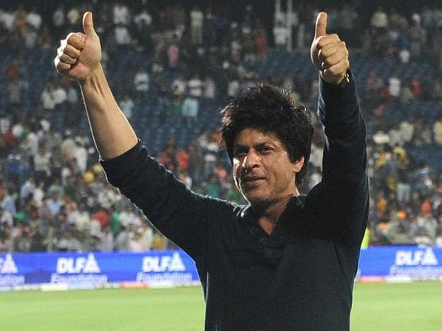 Bollywood star and Kolkata Knight Riders owner Shah Rukh Khan greets the crowd after his team won the IPL Twenty20 first playoff cricket match with Delhi Daredevils.