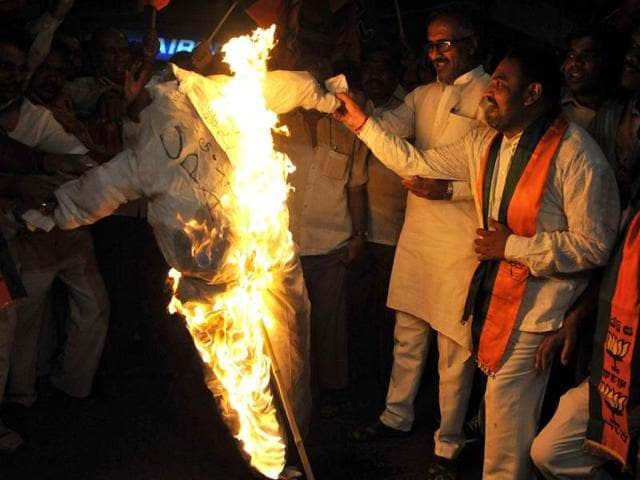 BJP protesters burn the effigy of UPA government against the petrol price hike, in Hyderabad. State-run oil firms announced a sharp hike in petrol prices to offset growing losses caused by subsidised rates, rises in the international oil price and a plunging rupee. The increase, the steepest in nearly a decade, was put at Rs 6.28 per litre which will mean a Rs 7.5/L hike, adding taxes, for consumers in metros. AFP/Noah Seelam