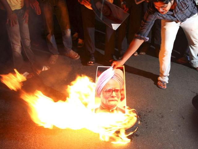 A protester burns a portrait of Prime Minister Manmohan Singh during a protest in Odisha against the steep rise in petrol prices. State oil companies raise the price of petrol for the first time in more than six months in a gesture of fiscal discipline that economists said is unlikely to give a significant lift to the embattled rupee. Reuters photo