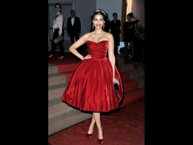 While-the-red-velvet-voluminous-dress-with-the-matching-shoes-looked-good-Sonam-s-scarlett-lips-and-golden-hair-accessory-looks-over-the-top