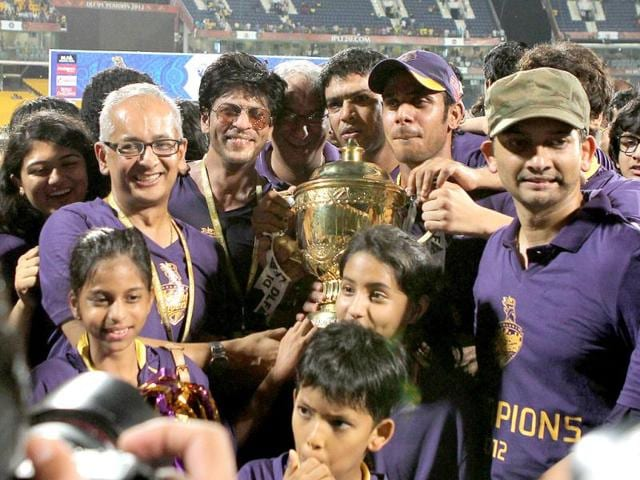 Shah Rukh Khan poses with the DLF IPL 2012 cup as he celebrates his team