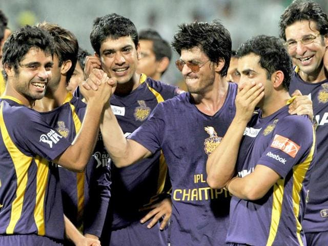 Shah Rukh Khan celebrates with his teammates.
