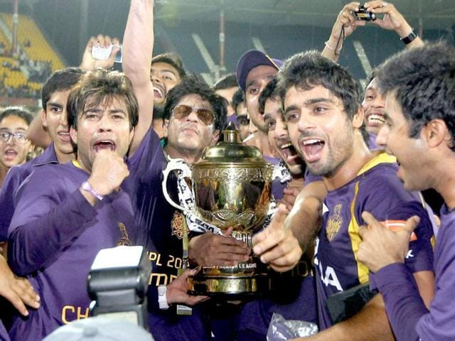 Shah Rukh Khan and players celebrate after the win.