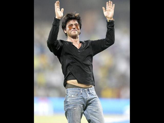 Bollywood-actor-and-IPL-franchise-Kolkata-Knight-Riders-co-owner-Shah-Rukh-Khan-brushes-aside-a-security-guard-blowing-a-whistle-to-direct-children-accompanying-him-off-the-playing-field-at-The-Wankhede-Stadium-in-Mumbai-AFP-PHOTO-Indranil-MUKHERJEE