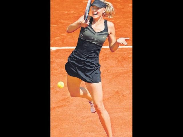 Maria-Sharapova-reacts-after-winning-against-Sara-Errani-their-Women-s-Singles-final-tennis-match-of-the-French-Open-tennis-tournament-at-the-Roland-Garros-stadium-in-Paris---AFP-Jacques-Demarthon