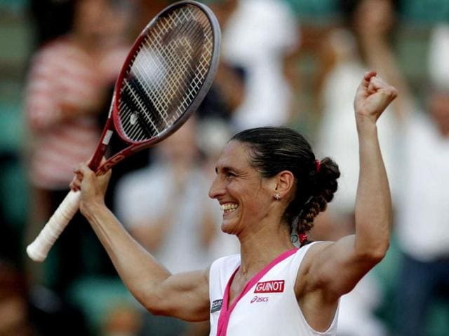 Virginie-Razzano-of-France-celebrates-after-winning-her-match-against-Serena-Williams-of-the-US-during-the-French-Open-tennis-tournament-at-the-Roland-Garros-stadium-in-Paris-Reuters