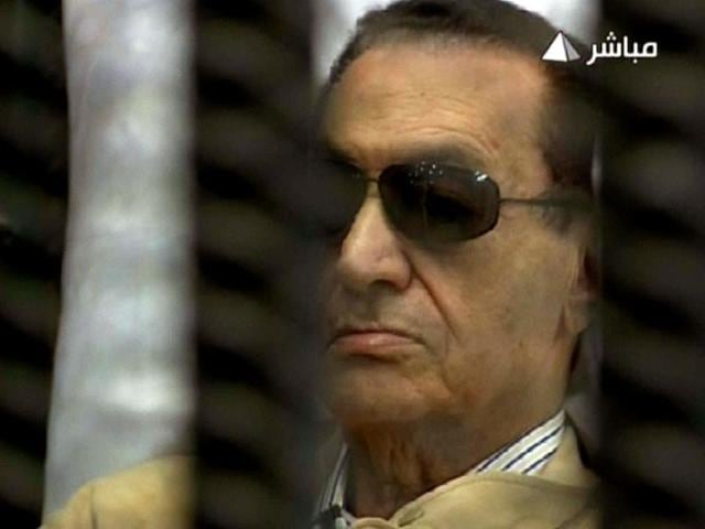 An-image-grab-taken-from-Egyptian-state-TV-shows-ousted-Egyptian-president-Hosni-Mubarak-sitting-inside-a-cage-in-a-courtroom-during-his-verdict-hearing-in-Cairo-AFP-photo