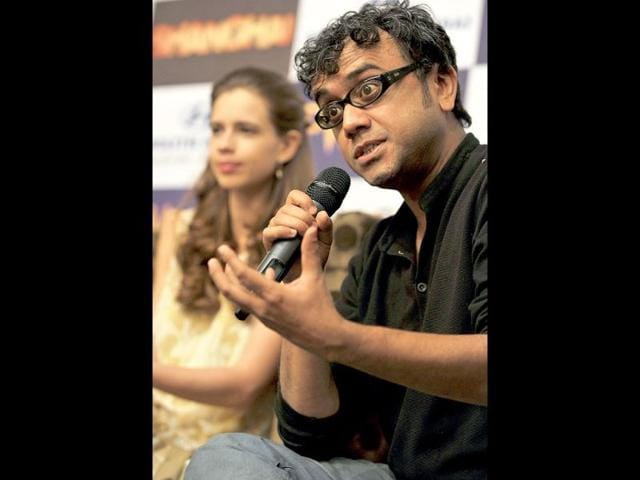 Bollywood-director-Dibakar-Banerjee-gestures-while-addressing-the-media-while-actress-Kalki-Koechlin-looks-on-during-a-promotional-press-conference-held-for-their-upcoming-movie-Shanghai-in-Bangalore-AFP