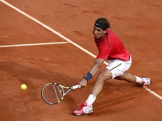 Spain-s-Rafael-Nadal-hits-a-return-to-Argentina-s-Eduardo-Schwank-during-their-Men-s-Singles-3rd-Round-tennis-match-of-the-French-Open-tennis-tournament-at-the-Roland-Garros-stadium-in-Paris-AFP-Photo-Pascal-Guyot