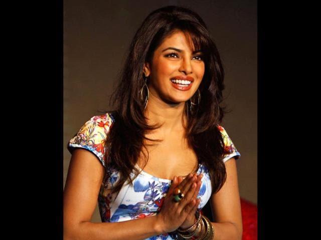 Bollywood-actress-Priyanka-Chopra-greets-at-a-press-conference-as-brand-ambassador-for-home-entertainment-brand-Digital-Direct-Broadcast-DDB-in-Mumbai-AP