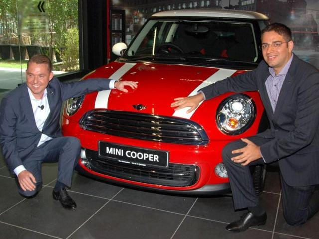 Andreas Schaaf, Pressident, BMW Group India, and Gaurav Bhatia, Managing Director, launching the new car MINI COOPER , at a press conference in New Delhi on Wednesday. Agencies