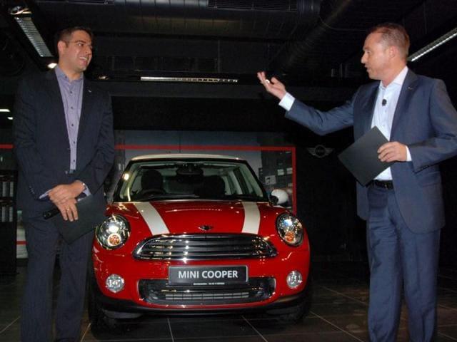 Andreas Schaaf, president, BMW Group India, and Gaurav Bhatia, Managing Director, launching the new car Mini Cooper, at a press conference in New Delhi. Agencies