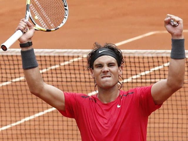 Rafael-Nadal-of-Spain-celebrates-winning-his-quarter-final-match-against-compatriot-Nicolas-Almagro-at-the-French-Open-tennis-tournament-in-Roland-Garros-stadium-in-Paris-Nadal-won-7-6-6-2-6-3-AP-Bernat-Armangue