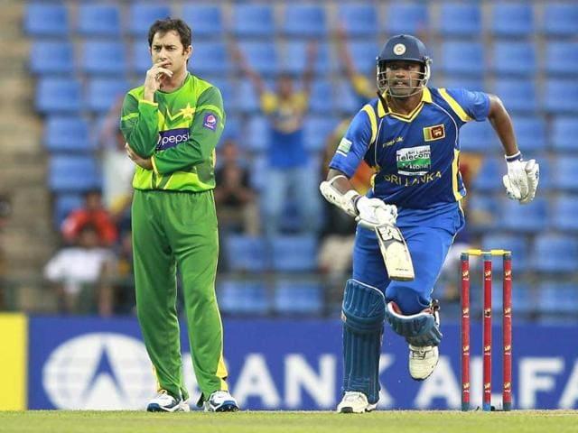 Pakistan-s-Saeed-Ajmal-L-looks-on-as-Sri-Lanka-s-Thisara-Perera-runs-between-wickets-during-their-first-One-Day-International-ODI-cricket-match-in-Pallekele-Reuters-Dinuka-Liyanawatte