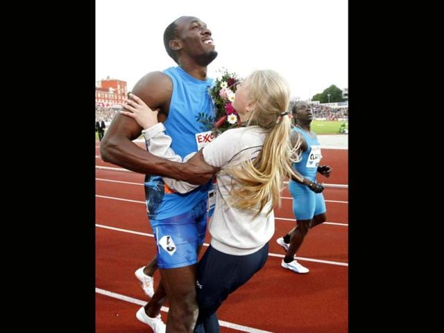 Usain-Bolt-of-Jamaica-collides-with-a-flower-girl-after-crossing-the-finish-line-to-win-the-men-s-100m-at-the-IAAF-Diamond-League-athletics-meeting-at-the-Bislett-Stadium-in-Oslo-AFP-Scanpix-Heiko-Junge