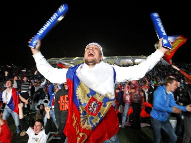 Russian-soccer-fans-react-as-watch-of-the-Euro-2012-soccer-championship-Group-A-match-between-Russia-and-Czech-Republic-on-the-screen-at-the-Luzhniki-stadium-in-Moscow-Russia-AP-Photo