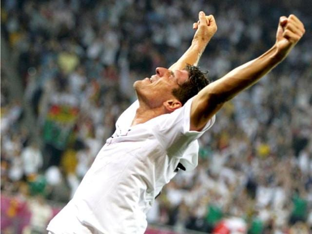 Germany-s-Mario-Gomez-celebrates-after-scoring-against-Portugal-during-their-Group-B-Euro-2012-soccer-match-at-the-new-stadium-in-Lviv-Reuters-Thomas-Bohlen