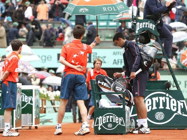 Serbia-s-Novak-Djokovic-leaves-the-court-after-his-Men-s-Singles-final-tennis-match-against-Spain-s-Rafael-Nadal-was-interrupted-during-the-French-Open-tennis-tournament-at-the-Roland-Garros-stadium-in-Paris-AFP-Kenzo-Tribouillard