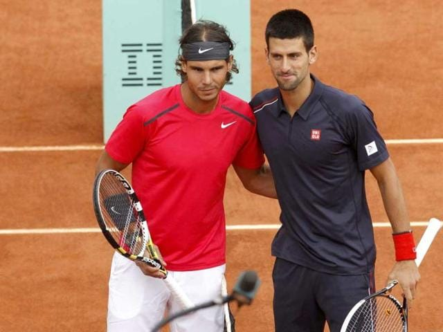 Rafael-Nadal-of-Spain-and-Novak-Djokovic-of-Serbia-pose-before-the-start-of-their-men-s-singles-final-match-during-the-French-Open-tennis-tournament-at-the-Roland-Garros-stadium-in-Paris-Reuters-Photo-Benoit-Tessier