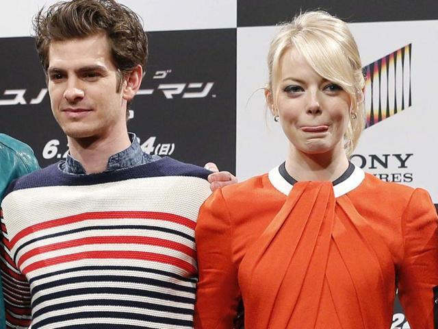 Cast-members-Andrew-Garfield-L-and-Emma-Stone-pose-after-their-news-conference-to-promote-the-film-The-Amazing-Spider-Man-Reuters