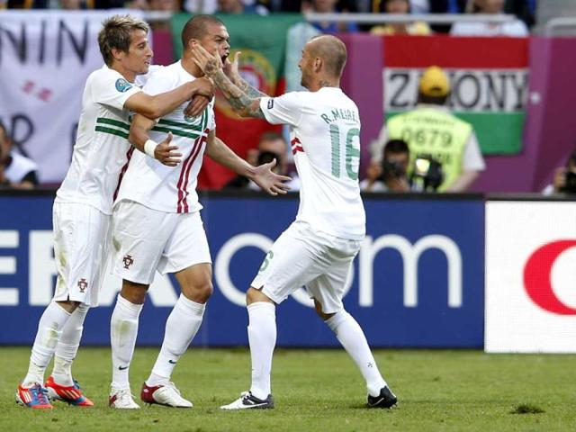 Portugal-s-Pepe-center-celebrates-after-scoring-a-goal-with-teammates-during-the-Euro-2012-soccer-championship-Group-B-match-between-Denmark-and-Portugal-in-Lviv-Ukraine-AP-Photo-Armando-Franca