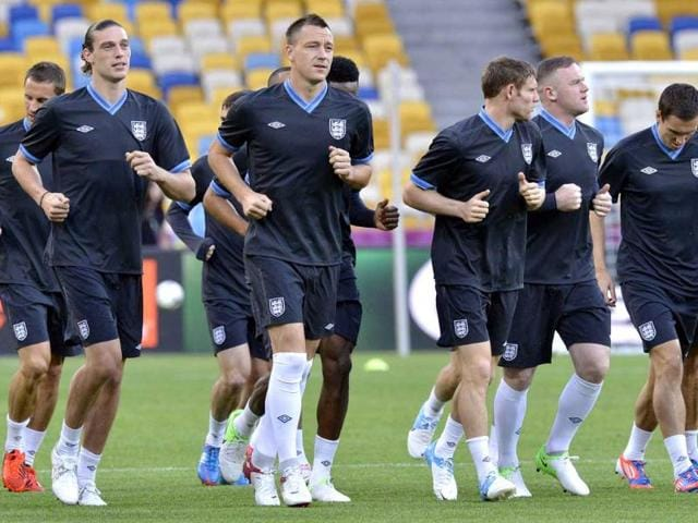 England-s-John-Terry-3rd-from-left-exercises-with-the-team-during-the-official-training-on-the-eve-of-the-Euro-2012-soccer-championship-Group-D-match-between-Sweden-and-England-in-Kiev-Ukraine-AP-Photo-Martin-Meissner