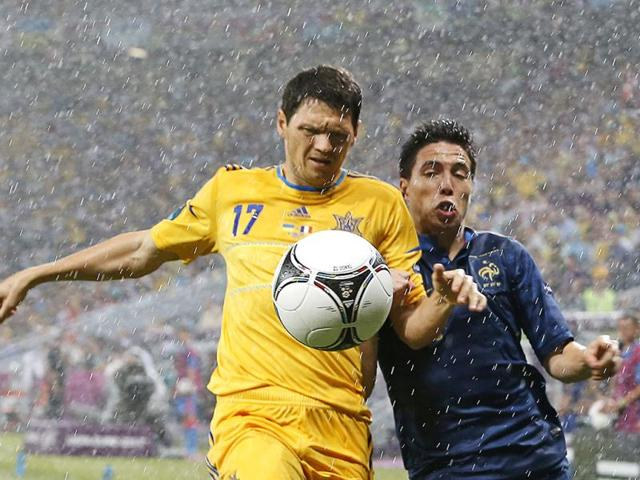 Ukraine-s-Taras-Mikhalik-left-and-France-s-Samir-Nasri-fight-for-the-ball-during-the-Euro-2012-soccer-championship-Group-D-match-between-Ukraine-and-France-in-Donetsk-Ukraine-AP-Photo-Matthias-Schrader