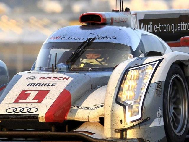 Audi-R18-TDI-No1-driven-by-Andre-Lotterer-of-Germany-is-seen-in-action-at-dawn-during-the-80th-24-hour-Le-Mans-endurance-race-in-Le-Mans-AP-Bob-Edme