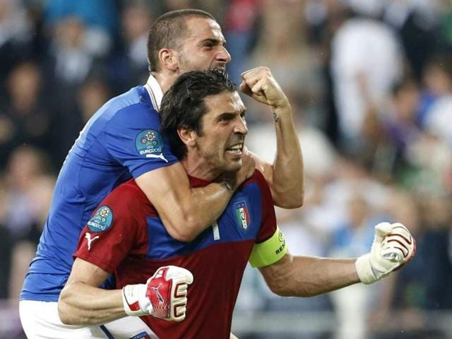 Italy-goalkeeper-Gianluigi-Buffon-front-and-Leonardo-Bonucci-celebrate-winning-the-Euro-2012-soccer-championship-Group-C-match-between-Italy-and-the-Republic-of-Ireland-in-Poznan-Poland-AP-Photo-Gregorio-Borgia