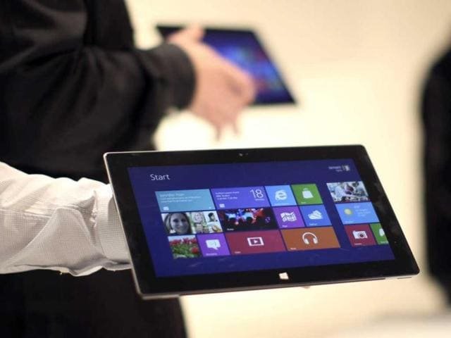 Microsoft-representatives-hold-a-new-Surface-tablet-computer-as-it-is-unveiled-by-Microsoft-in-Los-Angeles-California--Reuters-photo-David-McNew