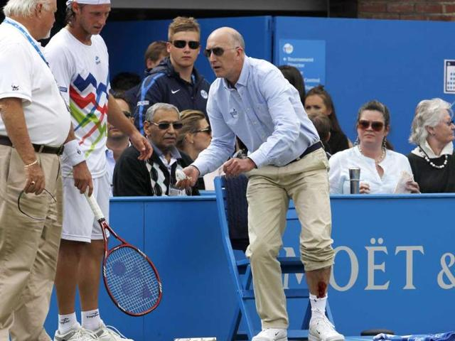 Line-judge-Andrew-McDougall-shows-his-injury-after-David-Nalbandian-kicked-a-hoarding-during-his-men-s-singles-final-match-at-the-Queen-s-Club-tennis-tournament-in-London-Reuters-Suzanne-Plunkett