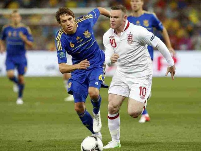 England-s-Wayne-Rooney-R-challenges-Ukraine-s-Denys-Garmash-during-their-Group-D-Euro-2012-soccer-match-at-the-Donbass-Arena-in-Donetsk-Reuters-Alessandro-Bianchi