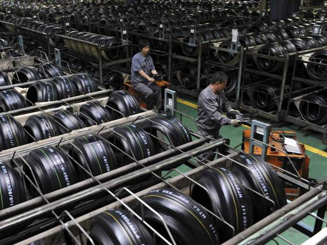 Chinese factories scrabble for growth in May, export demand shrinks